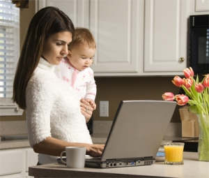 mom on computer with baby