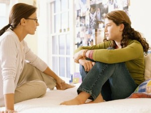 mom talking with teen daugther